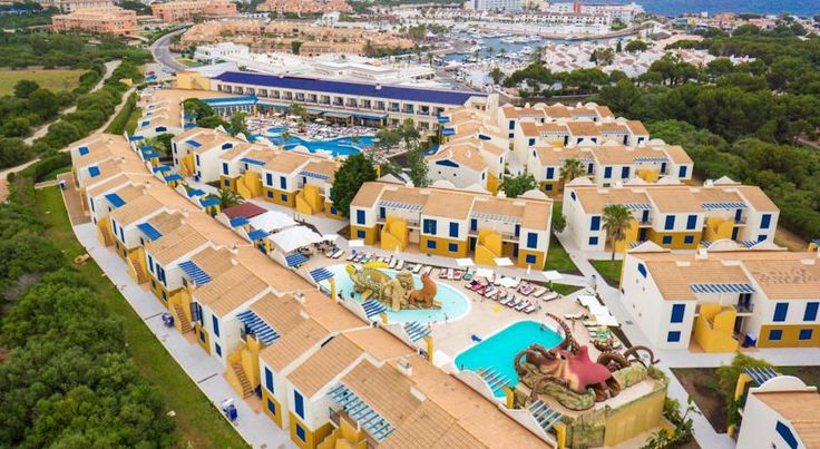 Aparthotel Paradise Club & Spa Cala en Bosch Just 100 metres from the beach, Aparthotel Paradise Club & Spa features a tennis court, 2 swimming pools and a spa.  Paradise Club & Spa offers well-appointed studio apartments with a terrace, bathroom, kitchen and living area.