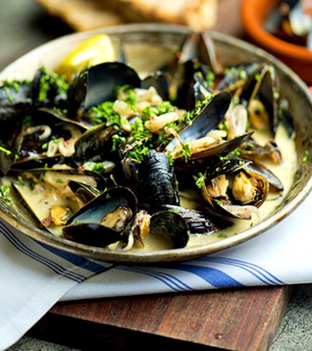 The best steamed mussels ever! This Thai mussel recipe makes an incredible appetizer or a romantic dinner for two. Fresh mussels are steamed in white wine, then lightly simmered in a basil-coconut sauce that's simply divine. The dish is finished off with more basil and fresh coriander. Serve with your favorite wine and a loaf of crusty French bread to soak up the juices. Enjoy!