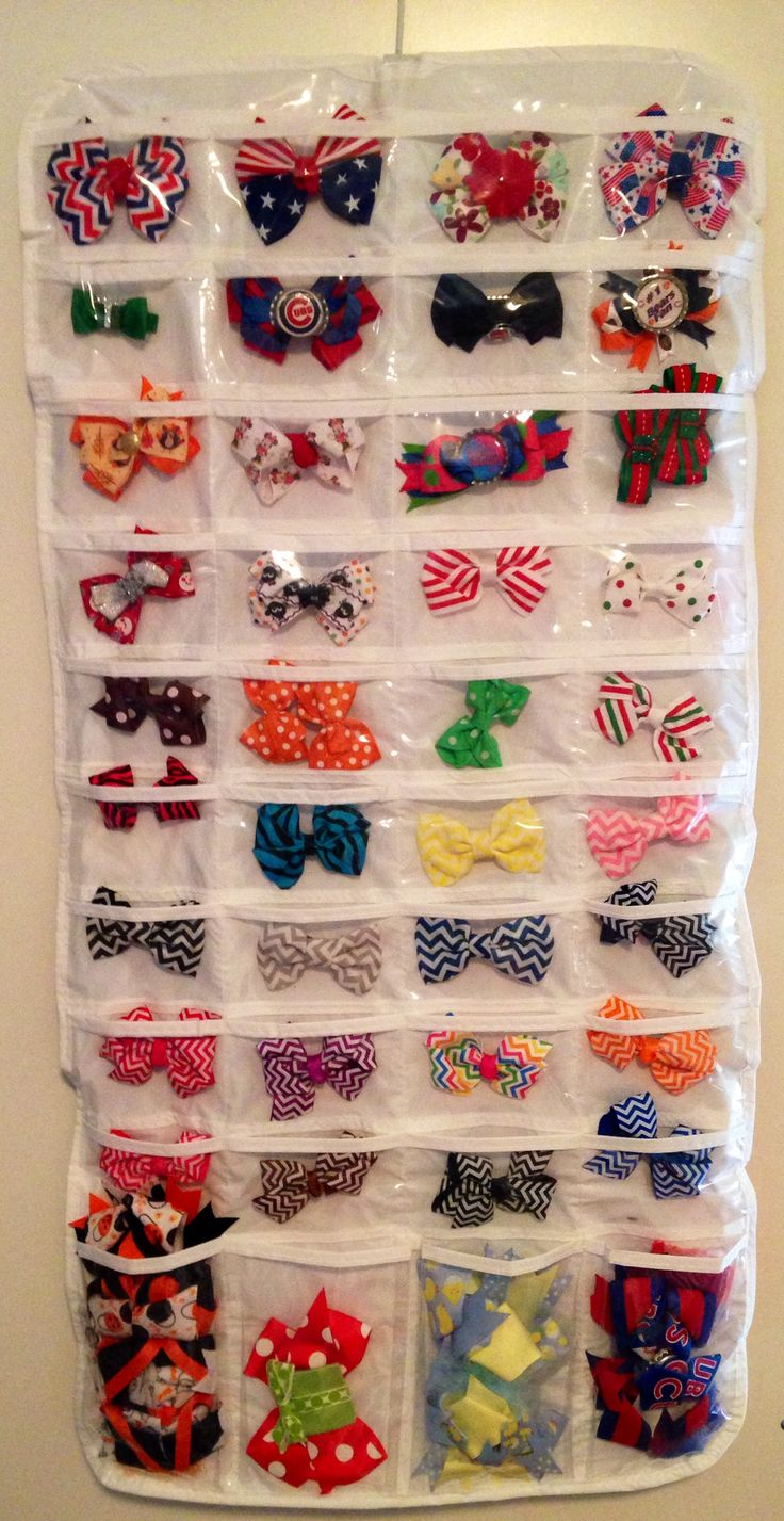 I actually organize the bows for my girls like this for vacation. I just roll it up to pack. Hang it on a door in the hotel...  no searching in bags.
