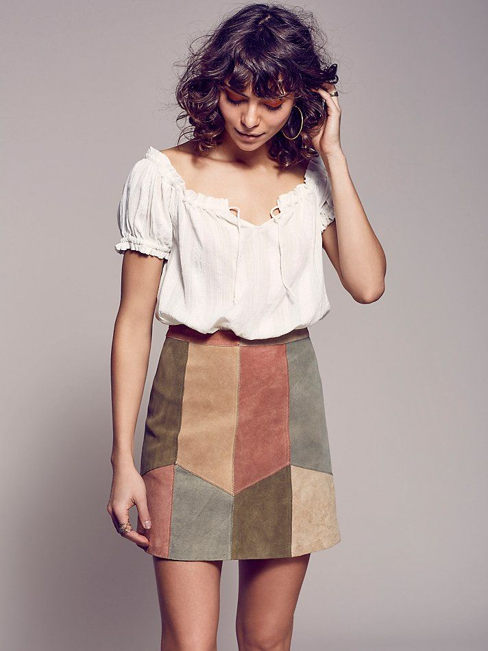 This Could Be Us Patchwork Mini | Luxe suede mini skirt features a multi-colored patchwork detailing. Hidden hook and zip closure in back.  Lined.