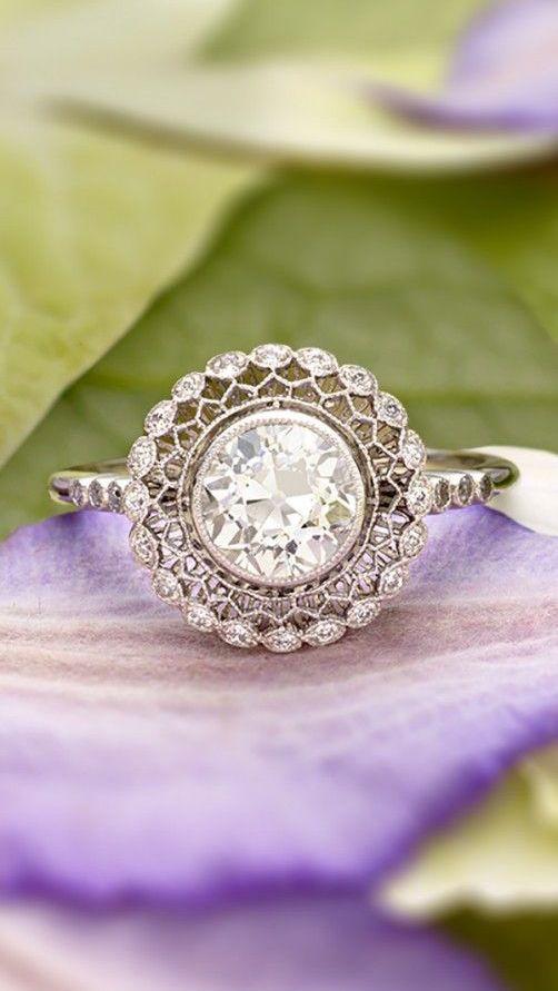 vintage-inspired ring encircles a bezel set diamond with lavishly detailed latticework