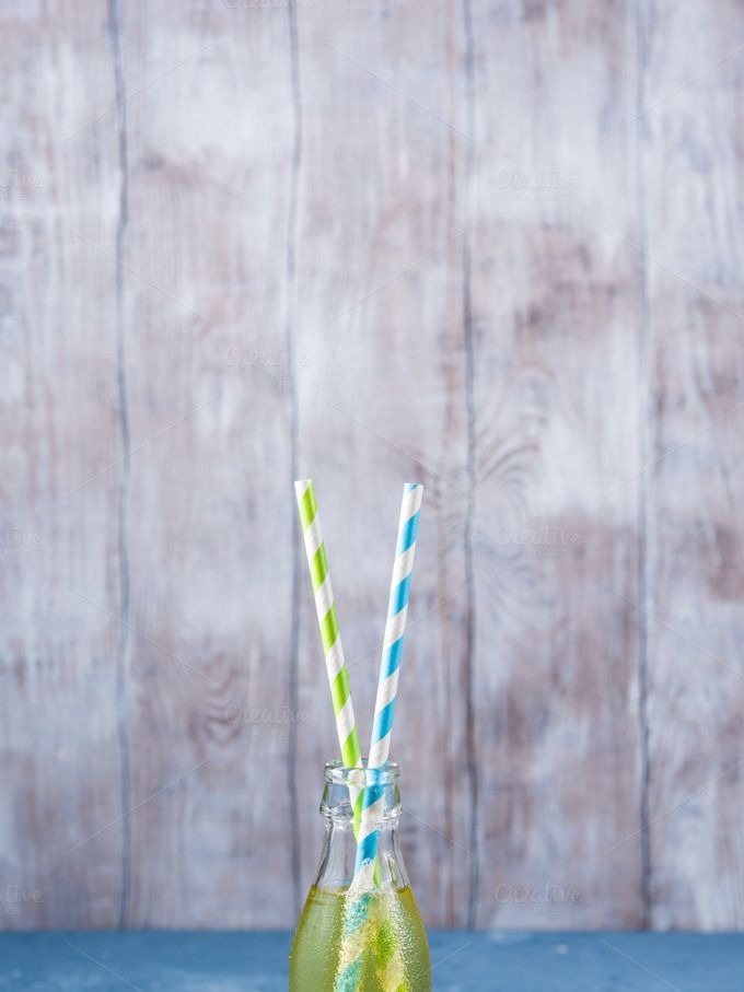 Lemon soft drink with straws by Life Morning Photography on @creativemarket