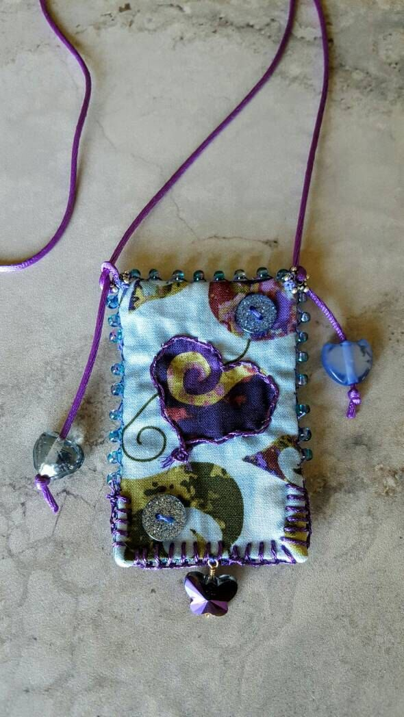 A personal favorite from my Etsy shop https://www.etsy.com/listing/385301002/statement-necklace-heart-pendant-fabric