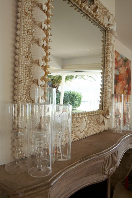 Beautiful mirror! I love all of the seashells on the frame.