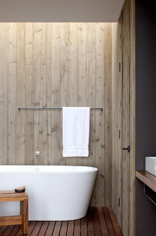 Love the modern look of the tub combined with old cedar walls and spa style floor. Holy cow!
