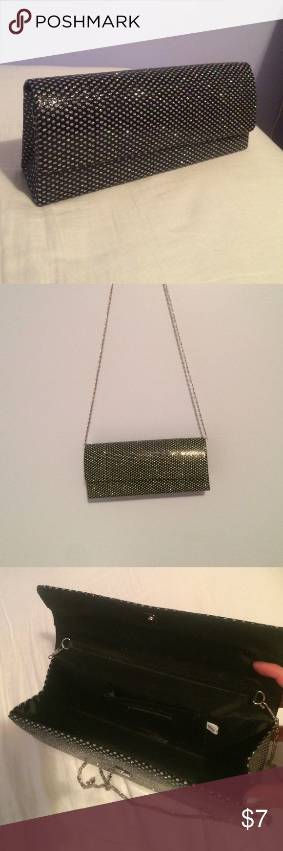 Sparkly black formal clutch Super cute black clutch that is very sparkly and shiny! Has a chain so you can wear on your shoulder instead of carrying it Expressions NYC Bags Clutches & Wristlets