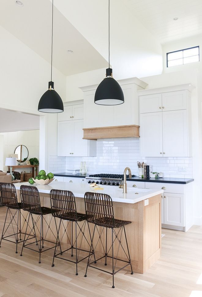 White Kitchen With Light Oak Island And Light Wood Floors The