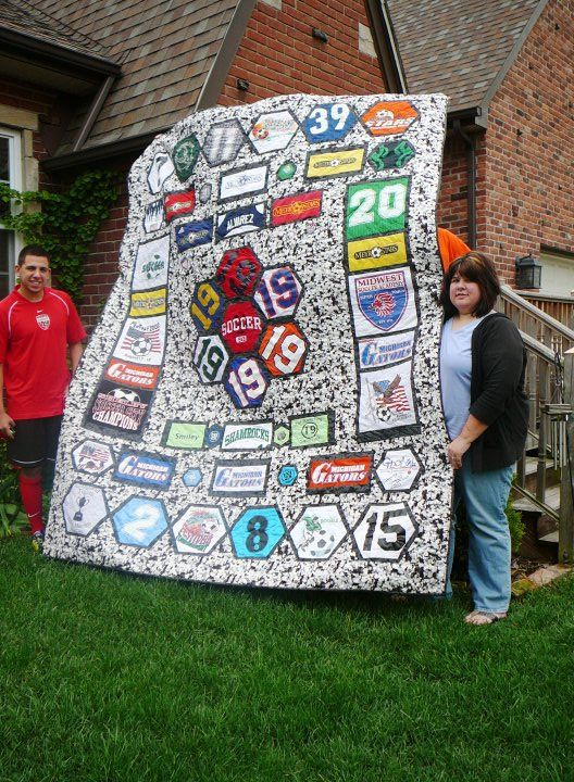 This is the quilt that I had made for my son for his high school graduation. It's all of his soccer jersey's and t-shirts from the age of 4 till 18. It's just awesome!