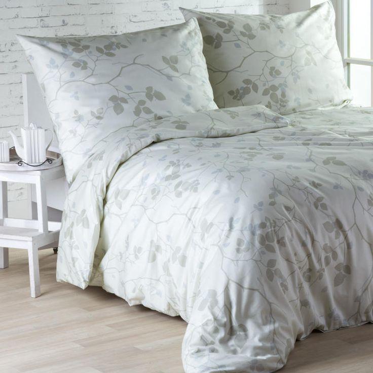 Saténové posteľné prádlo Rami - Saténové posteľné obliečky Rami Vás očaria špeciálnou leštenou úpravou. Jemný dizajn v podobe šedých a béžových lístkov a vetvičiek pôsobí elegantne a pokojne. V sade n