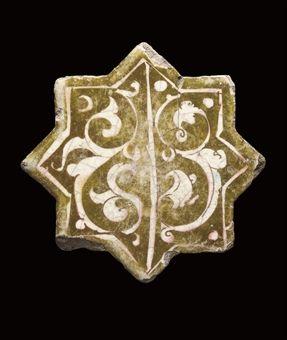 A KASHAN LUSTRE POTTERY STAR TILE, IRAN, CIRCA 1200