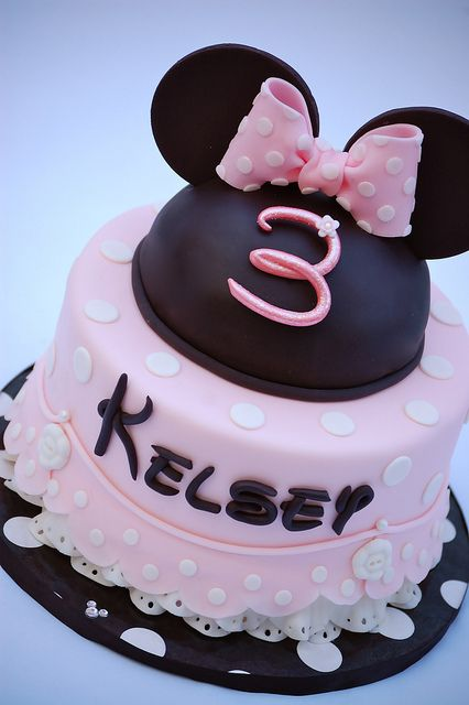 Minnie Mouse cake for Olivia. Use a real bow? Iced rice crispy treats for ears?