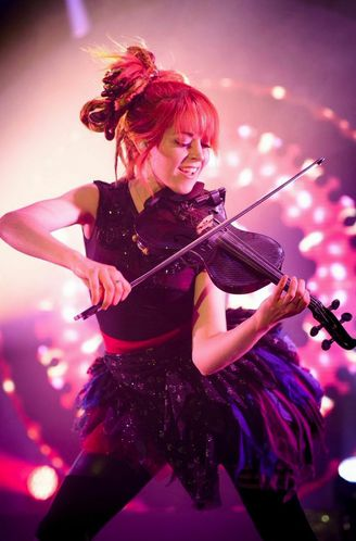 Lindsey Stirling - easy on the eye, but think it's safe to say that violin playing and dancing are not natural bedfellows. Just saw her on TV and no idea what it was all about