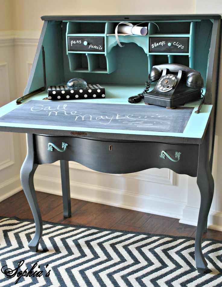 The outside of the secretary was painted in ASCP Graphite (love that color) with Provence painted drawer pulls, custom hand-painted phone graphic on the front and sealed with clear wax. inside compartments =  ASCP Provence