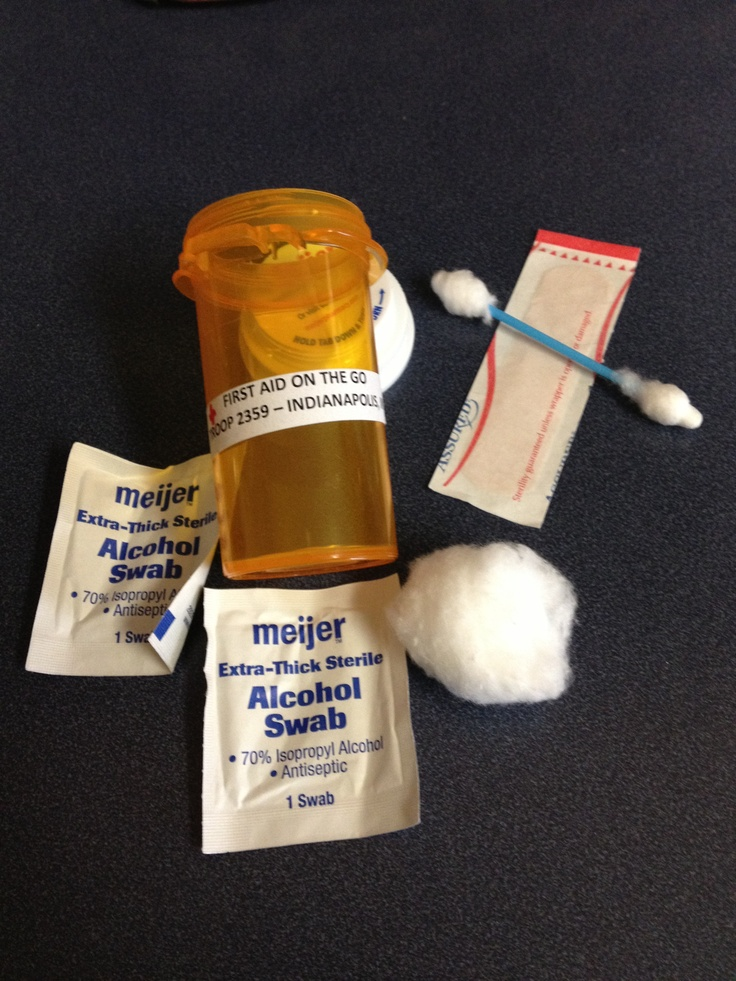 Girl Scout Swap--First Aid Kit. Includes cotton ball, Q-tip, 2 alcohol swabs and a band-aid in a prescription bottle. Don't forget to wash and sanitize your bottles prior to making these.