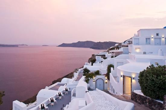 The exterior of this Oia, Greece hotel is carved out of the cliffside, resulting in bright white walls and unparalleled views of the Aegean Sea. Tres romantic, no?