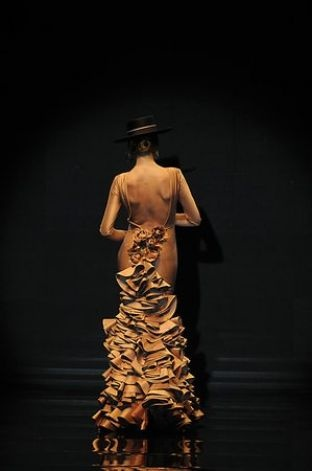 A model presents a creation by Spanish designer Vicky Martin Berrocal during the SIMOF 2011 (International Flamenco Fashion Exhibition) in Sevilla. Photo: Getty Images / SL
