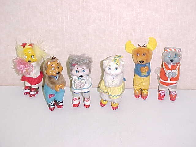 LOT OF 6 VINTAGE TOY ANIMALS WITH ROLLER SKATES AND SWIVEL HEADS