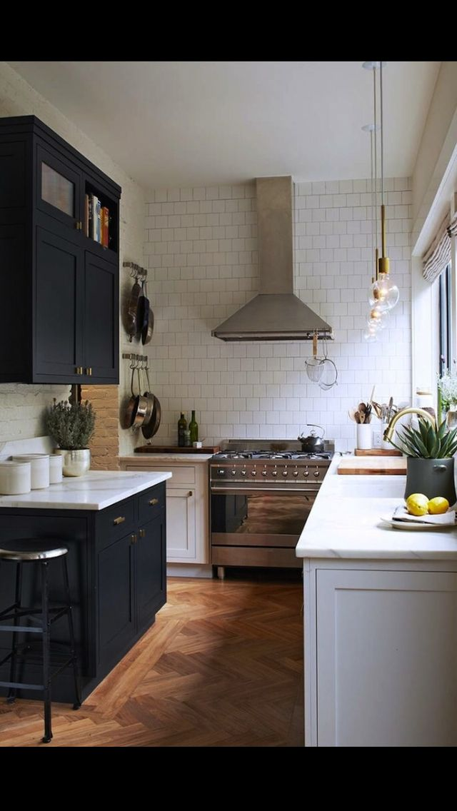 Black and white in a small kitchen, love the herringbone floor and white subway tiling.  I really like this aesthetic.