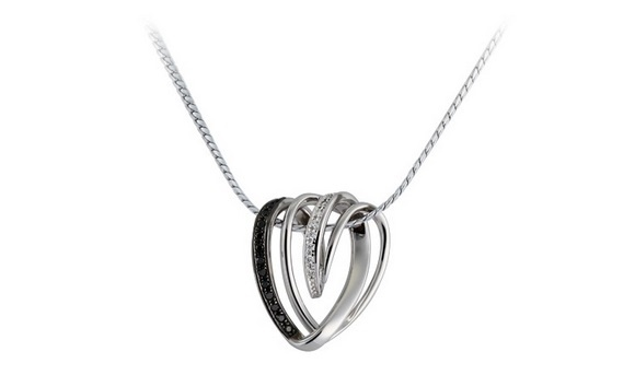 Masterfully crafted from 18 K white gold, the Forever Diamond Pendant symbolises the gentle tenderness that can be found between two people in love. The heart-shaped pendant is inlaid with a trail of black diamonds along one side and a path of white diamonds on the other, creating a fascinating juxtaposition between the two