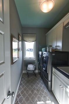 laundry room with turquoise ceiling | House of Turquoise: Karista Hannah and Lauren Harp