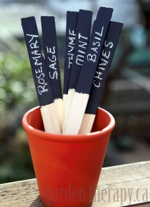 DIY Chalkboard Paint Herb Markers.  I see this as a great gift idea for a child to present to someone in their life who likes to garden.: