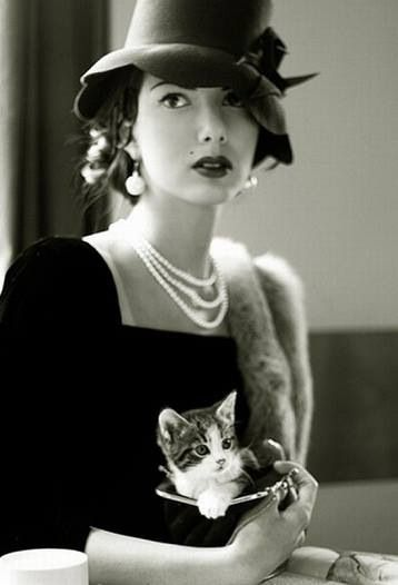 Vintage kitty. J/k  Look at that dress and hat, can you say gorgeous.