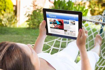 Woman On Hammock Reading News