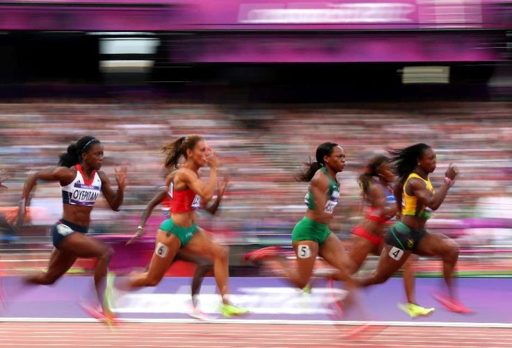 (L-R) Abiodun Oyepitan of Great Britain, Ivet Lalova of Bulgaria, Gloria Asumnu of Nigeria and Veronica Campbell-Brown of Jamaica compete in the Women's 100m Round 1 Heats on Day 7 of the London 2012 Olympic Games.