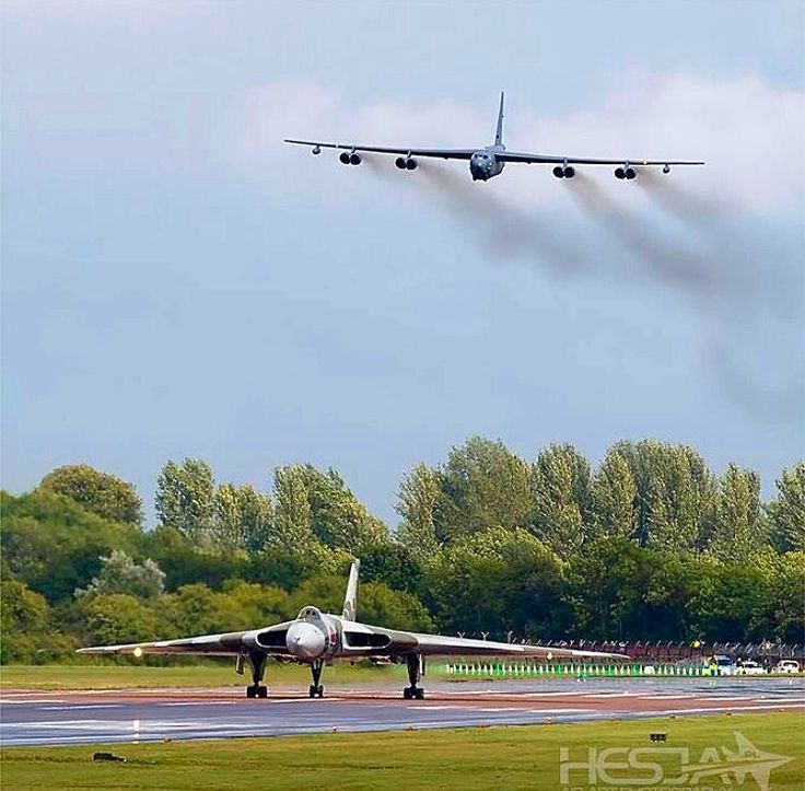 An Avro Vulcan starts its takeoff as a B-52 over flies it.