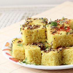 Khatta Dhokla (Mild Sour and Salty Spongy Cake made from Rice and Gram Lentils and seasoned with Spices)