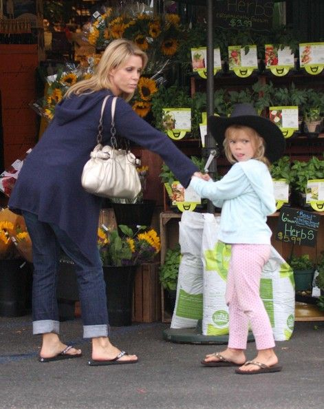 Actress Cheryl Hines and her daughter Catherine Rose Young out getting some groceries at Whole Foods in Brentwood, CA. Herb Appeal:   Cheryl Hines looks like she's stopping for some fresh herbs or flowers, while her five-year-old daughter Catherine goes incognito in a sweet cowboy hat.