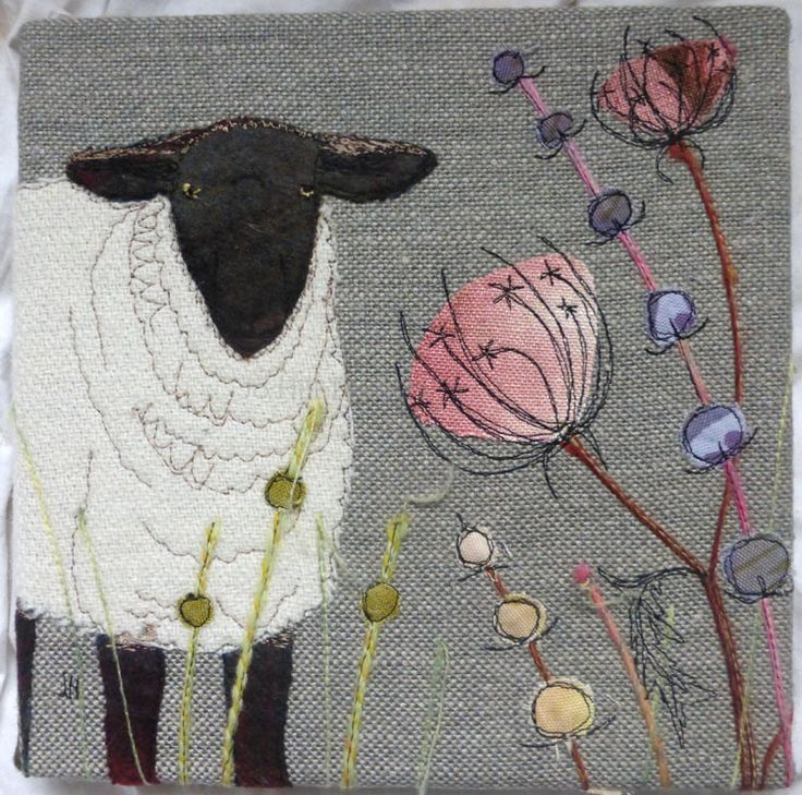 The machine embroidery could easily be done by hand. Sheep in a field.