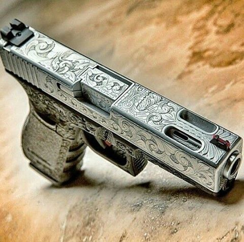 Engraved Glock 20. #weapon #weapons #gun #guns #pistol #rifle #sniper #glock #shoot #ammo #bullets #shootingrange #target #hunting #gunporn