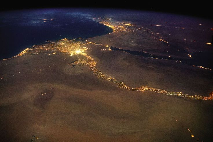 The bright lights of Cairo announce the opening of the north-flowing Nile's delta, with Jerusalem answering to the northeast.