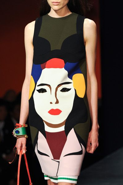 Prada Spring 2014 Pop art, showing influence from artists like Andy Warhol, was a huge influence in this show for Prada and shows how fashion always goes back to the past.