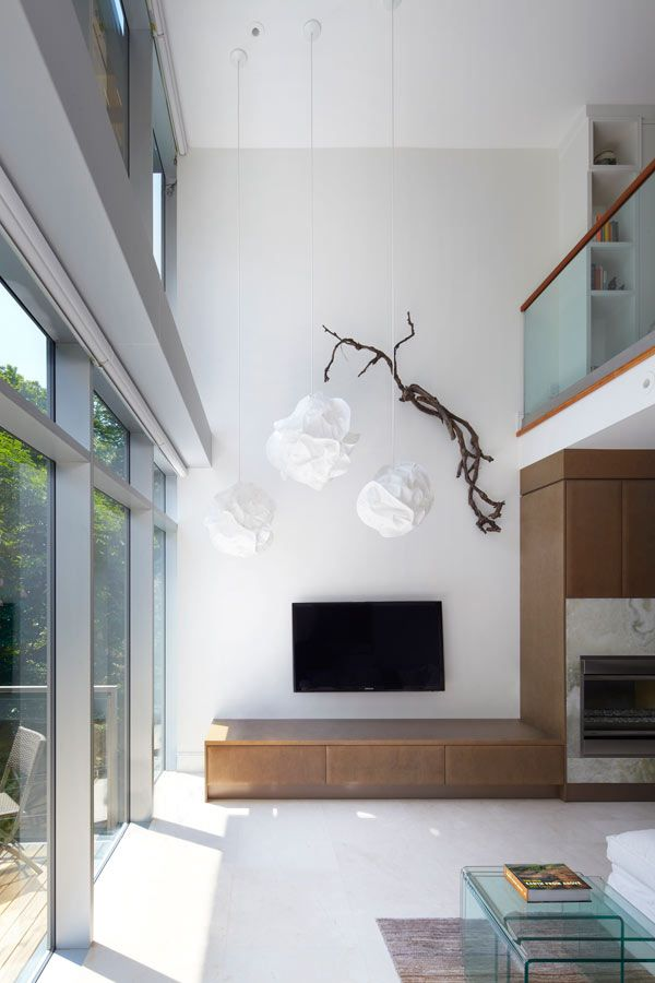 Interesting, natural, and relatively cheap solution to break up a tall, white wall with a tv at the bottom.