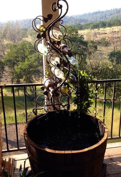 diy wine fountain, how to, outdoor living, ponds water features, repurposing upcycling, Wine bottle fountain with barrel