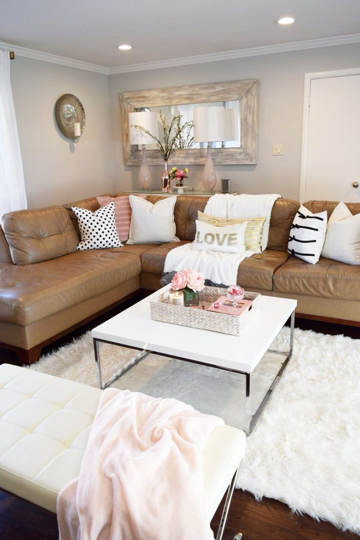 Refresh your living room with a few key pieces. A new throw, a couple pillows, faux flower arrangements and a vase.  An easy and inexpensive way to restyle! HomeGoods Sponsored Pin.