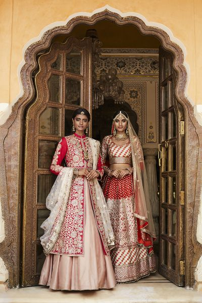 Bridal Lehengas - Pink and Red Bridal Lehengas with Silver Embroidery and Net Dupattas | WedMeGood #wedmegood #indianbride #indianwedding #bridallehenga #silver #red #pink #weddinglehenga