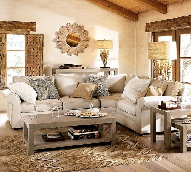 I love the rough materials used together with the cream couch and artistic pieces.