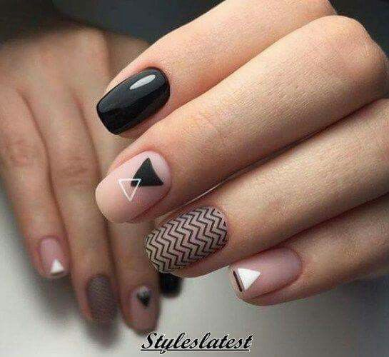 White closed eye on black nail, gold/silver sparkle instead of zigzag