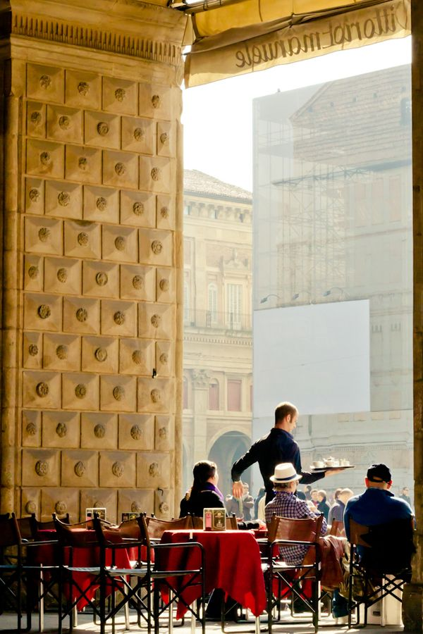 Piazza Maggiore, Bologna, Italy: Dino Gavina was born just outside Bologna in 1922. The son of a builder, he was an unruly child and had little formal  education. He began work as a doorman at a theatre, and from there progressed to helping to make set designs. By 1948 he  had a backstreet workshop that made, among other things,seats for army jeeps,as well as occasional items of contemporary furniture.(New York Times 2007)