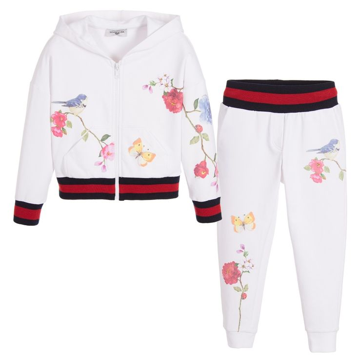 Girls white hooded tracksuit by Monnalisa Bimba. Made in a soft sweatshirt jersey, with a woven feel inside and a pretty, diamanté embellished floral print. The zip-up top has a pouch pocket, with navy blue and red ribbing on the sleeve cuffs and hem. The tracksuit trousers have a ribbed waistband and leg cuffs, with two back pockets.