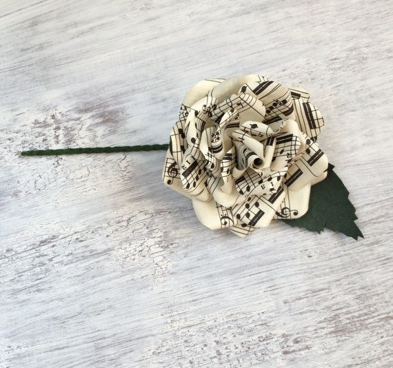 This buttonhole boutonnière is made from Vintage Music Sheet with green paper…