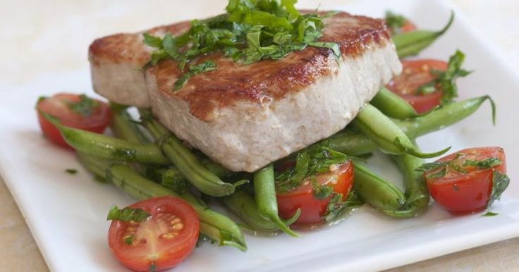 A tuna steak is a thick cut of fish suitable for grilling or baking. Tuna's naturally oily texture makes it an ideal choice for cooking over an outdoor barbecue, because the fish retains its texture and juiciness when grilled. Bake tuna in the oven on its own, or brush it with a marinade. Cooking times vary depending on the thickness of...