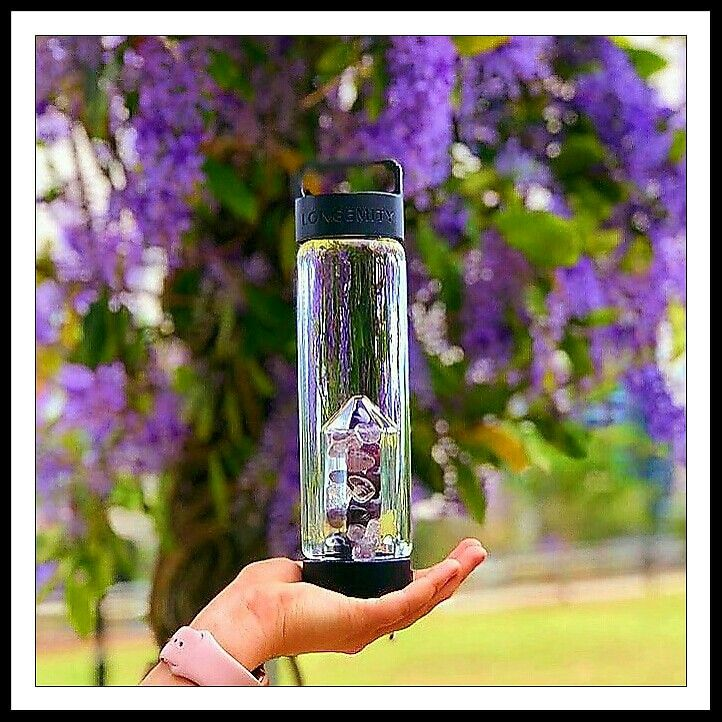 Vibration hydration. The power of  crystal healing for the mind, body and spirit in our convenient, easy on the go water bottle. Tjis is our Amethyst and Clear Quartz blend we called Aspirations