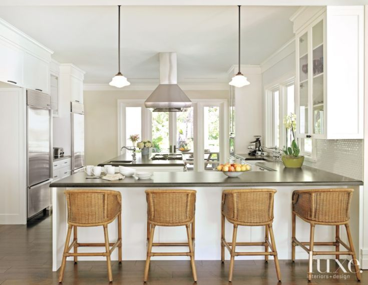 Transitional White Kitchen With Rattan Barstools