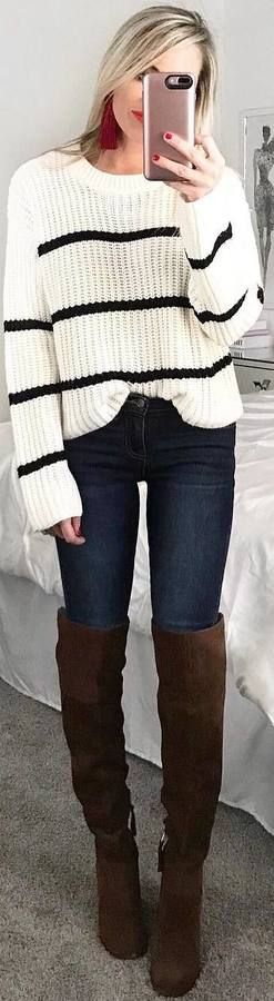 striped white sweater, jeans, long brown boots