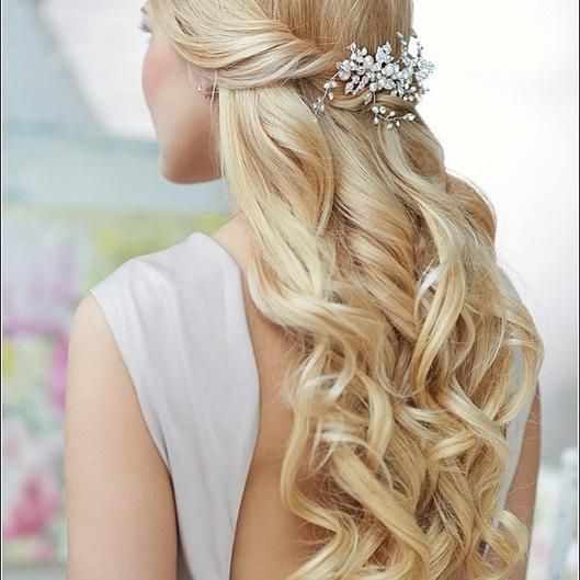 Half Up Half Down Hairstyles for Prom | Beauty High Twist the front two sections of hair back until they meet at the center of the back of your head, and secure the hair with an embellished clip.   Read more: http://beautyhigh.com/half-up-half-down-prom-hairstyles/#ixzz2zYIbvPRm