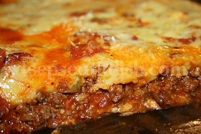 Upside Down Deep Dish Pizza Casserole Recipe ~ Says: this casserole style dish gives you the flavor of pizza, but in much less time.  Layers of ingredients, beginning with Mozzarella cheese, topped with a meat sauce, and finished with a batter that produces a crust-like layer, makes this casserole much like an upside down deep dish pizza.  We like green bell pepper, onion, beef and pepperoni on ours, but make it your own by adding your favorite pizza toppings.